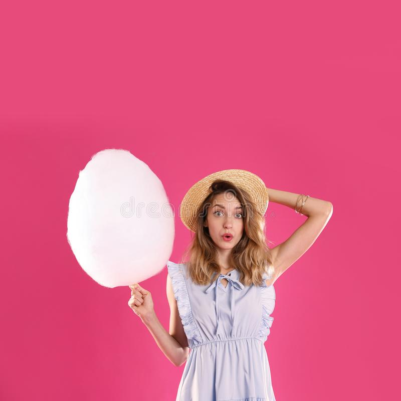 Emotional young woman with cotton candy stock photos