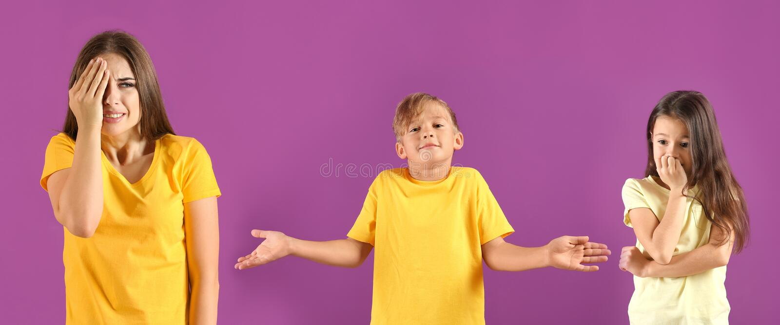 Emotional young woman after making mistake on color background royalty free stock image