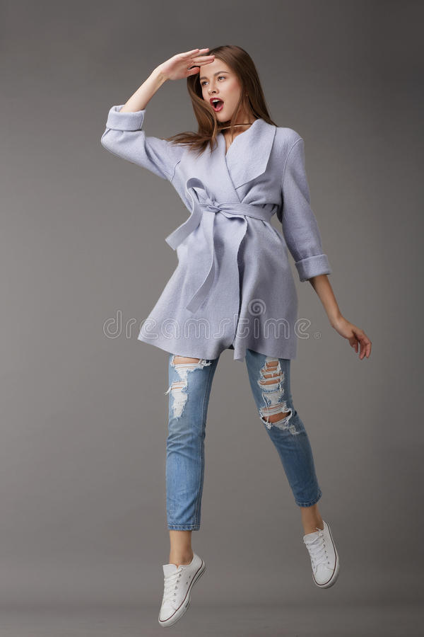 Emotional Young Woman in Outer Garments. Emotions. Young Woman in Outer Garments royalty free stock photo