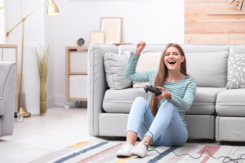 Emotional young woman playing video games royalty free stock images