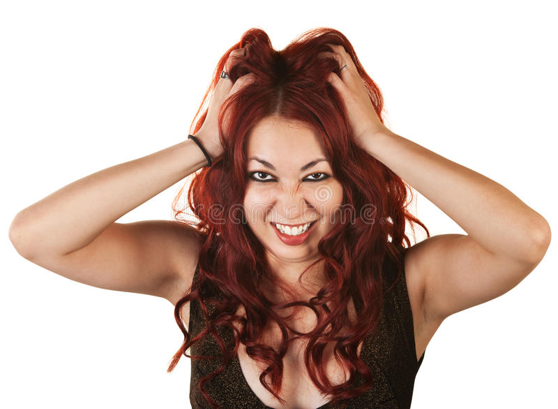 Emotionale Frau, die ihr Haar zieht lizenzfreies stockfoto