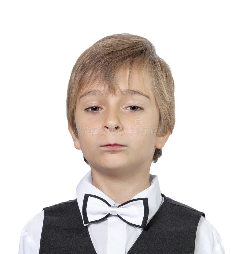Emotionales Porträt eines arroganten Jugendlichjungen Lokalisiert auf Whit lizenzfreie stockfotografie