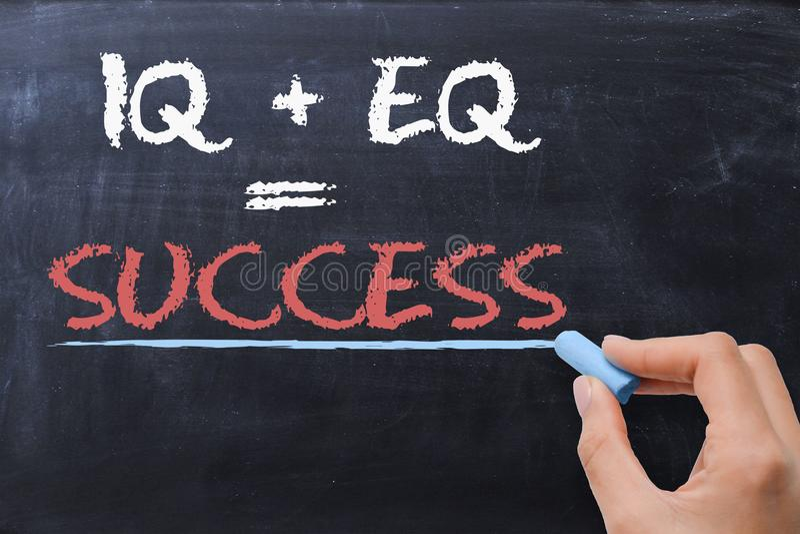 Emotioneel quotiënt EQ plus IQiq - Succesformule stock foto's