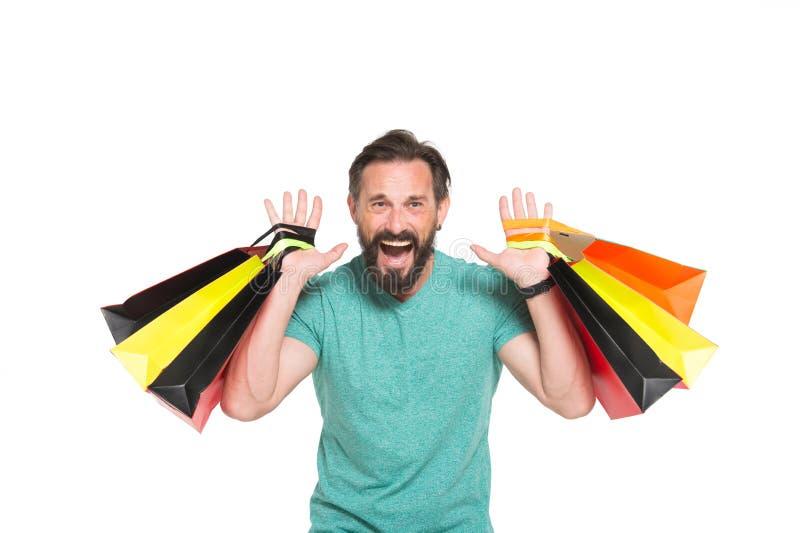 Emotionele verkooptijd Mensen gek over het winkelen Uiterst gelukkige mens met gekleurde het winkelen zak in handen op witte acht stock foto's