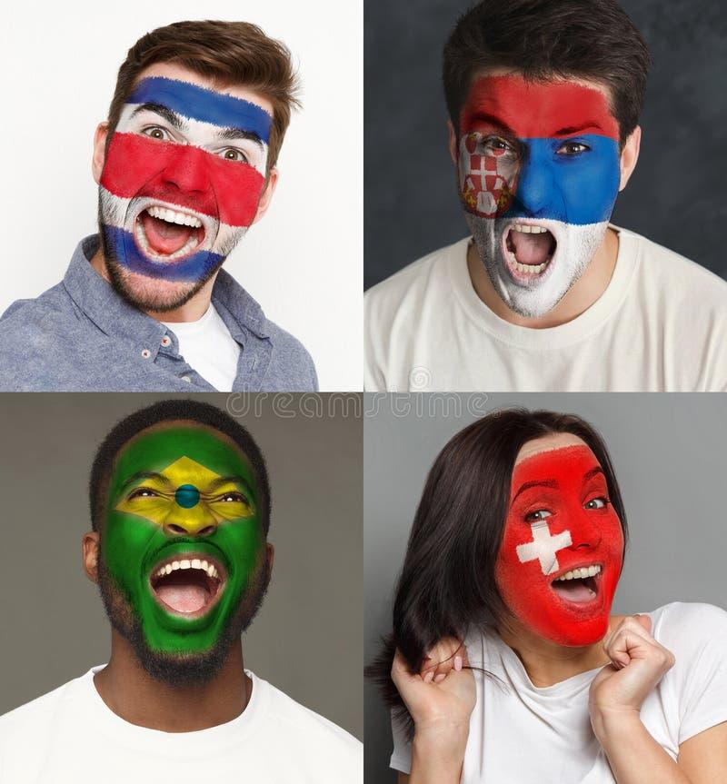 Emotionele voetbalventilators met geschilderde vlaggen op gezichten royalty-vrije stock afbeeldingen