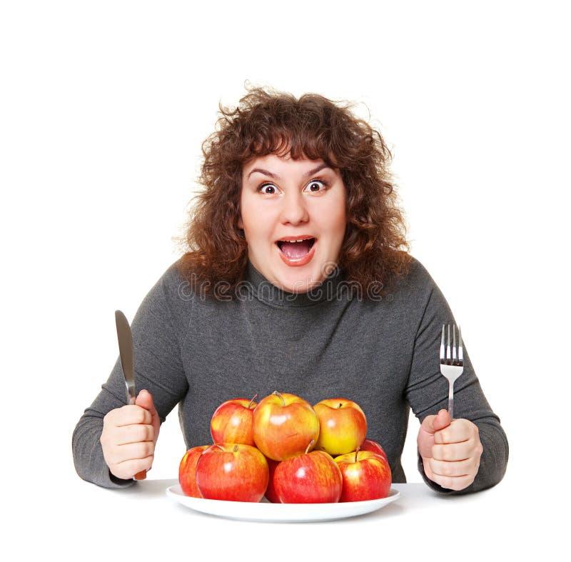 Emotionele vrouw met appelen stock afbeelding