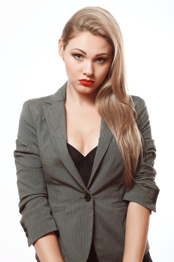 Emotionell blondin i en affärsdräkt royaltyfria foton