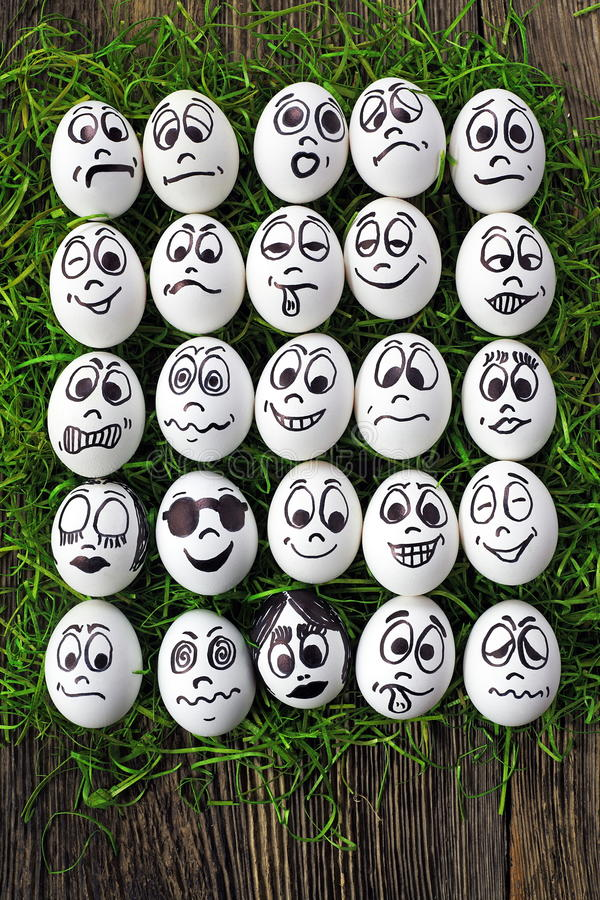 Emotions. White eggs and many funny faces stock photo