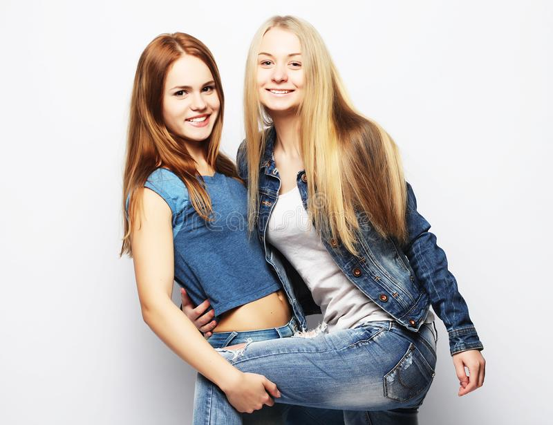 Emotions, people, teens and friendship concept - happy smiling pretty teenage girls or friends hugging royalty free stock image