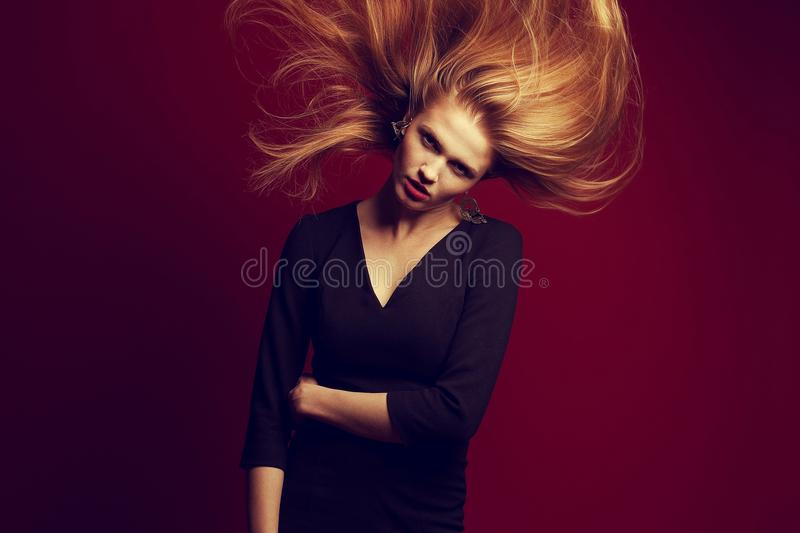 Emotive portrait of a beautiful red-haired ginger girl stock photos