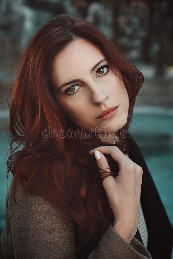 Emotive portrait of red haired woman stock images