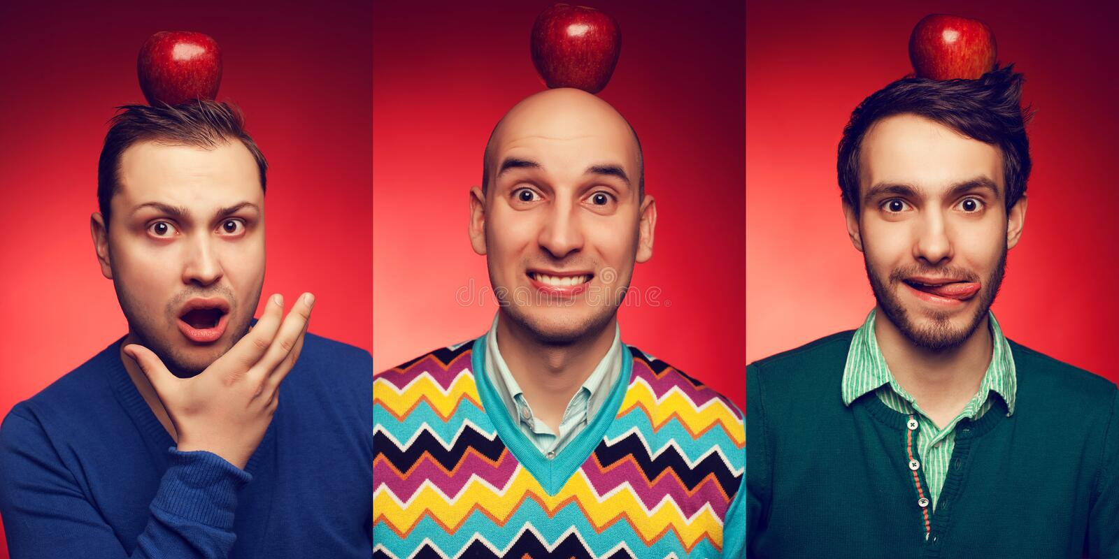 Emotive portrait of three funny and confused students posing over red background with red apple on head. Education (healthcare) c royalty free stock photo
