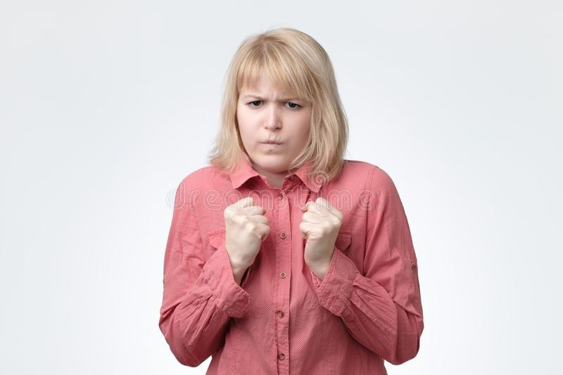 Emotive young female model looks nervously feels anxious. People reaction and facial expressions on bad news stock image
