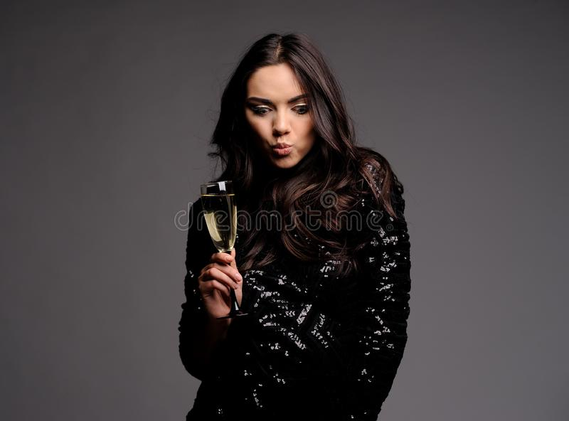 Emoyional Portrait of Beautiful Sensual Woman with glass of champagne royalty free stock photo