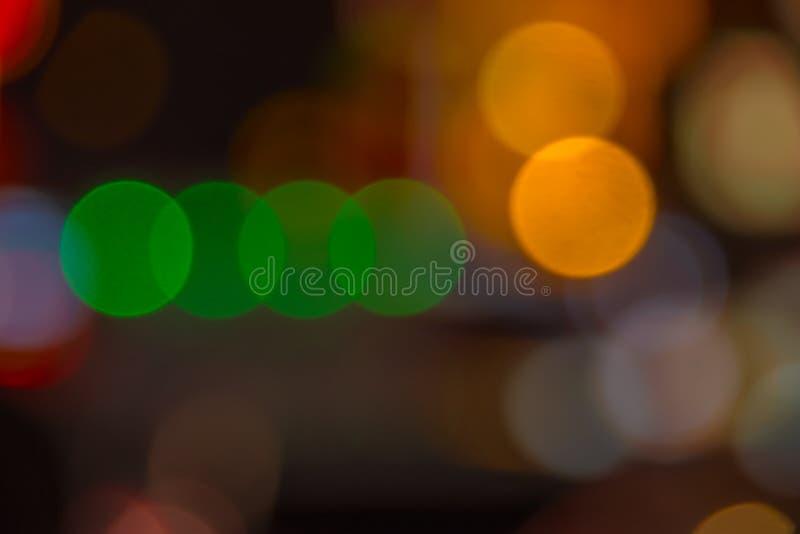 Empañe el bokeh abstracto del fondo de la luz de la noche de la ciudad de la calle foto de archivo libre de regalías