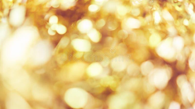 Empañe el fondo de la luz del bokeh del color oro, popular en el festival general Haga la imagen de lujo en su pedazo del trabajo fotografía de archivo libre de regalías