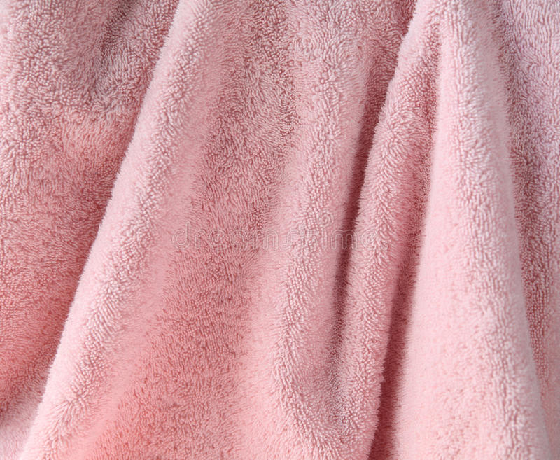 Empalideça - o fundo cor-de-rosa de toalha imagem de stock