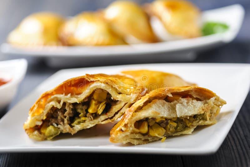 Empanada - вареники заполненные с мясом и овощем стоковые изображения rf