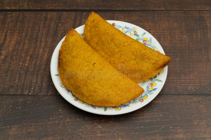 Empanada fried with spicy sauce, food Colombian, Latin American stock photography