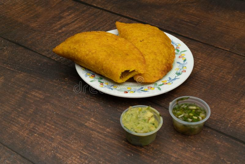 Empanada fried with spicy sauce, food Colombian, Latin American royalty free stock photography