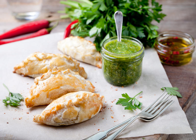 Empanadas with meat and green chili sauce. Traditional mexican dish. Empanadas with ground meat and green chili sauce. Traditional mexican dish stock photos