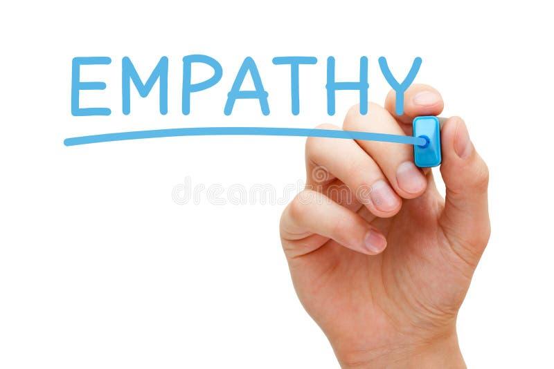 Empatia di parola scritta a mano con l'indicatore blu immagini stock libere da diritti