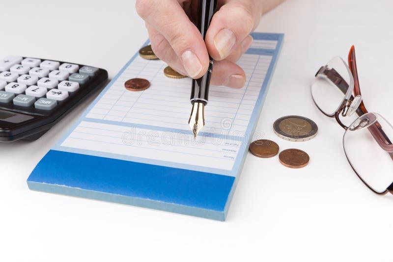 Empfangs-Buchfüllfederhalter und -taschenrechner stockfotos