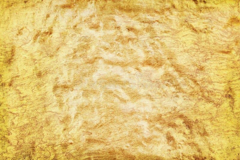 Empfindliche Farbe der alten Beschaffenheit Goldauf Betonmauer in den nahtlosen rauen Mustern für Hintergrund lizenzfreie stockfotos