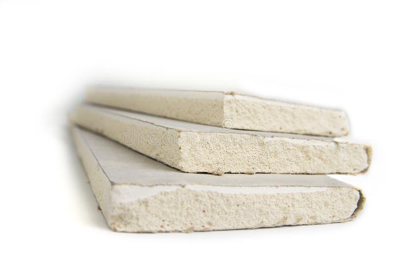 Empilhamento dos pain?is, do drywall ou da placa de gesso branca da gipsita imagens de stock royalty free