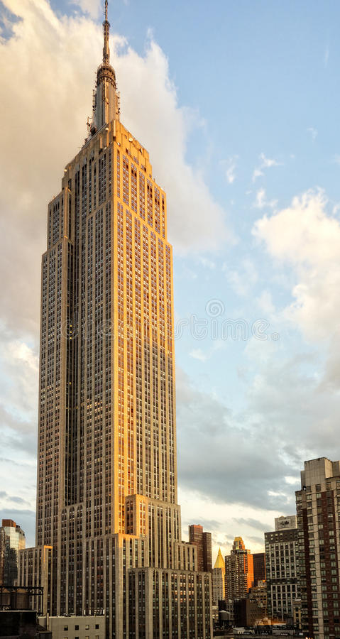 Empire State Buidling. NEW YORK CITY - June 21 - The Empire State Building is a iconic skyscraper located in mid-town Manhattan, New York, USA, stands tall in royalty free stock image