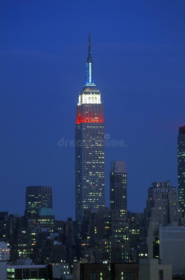 Empire State Building jak Nowego przy nocą widzieć od Weehawken - bydło obrazy stock