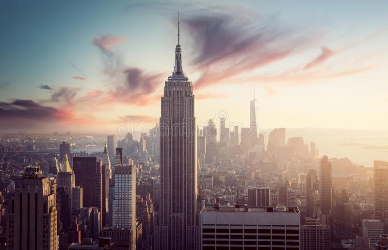 Empire State Building with New York Skyline. At surise/sunset royalty free stock photo