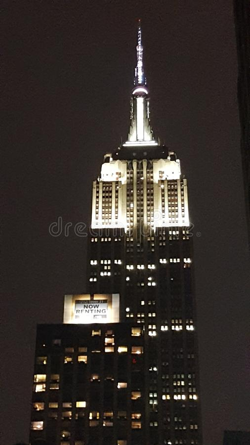 Empire State Building at night. The Empire State Building lit up in white light at nighttime royalty free stock images