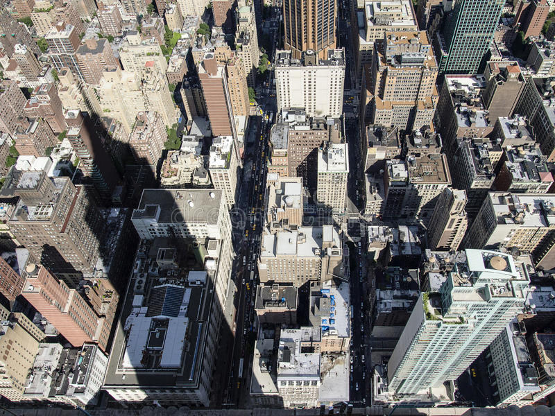Empire State Building Shadow. On a sunny day, the shadow of the Empire State building extends over blocks of buildings throughout midtown Manhattan in New York royalty free stock photo