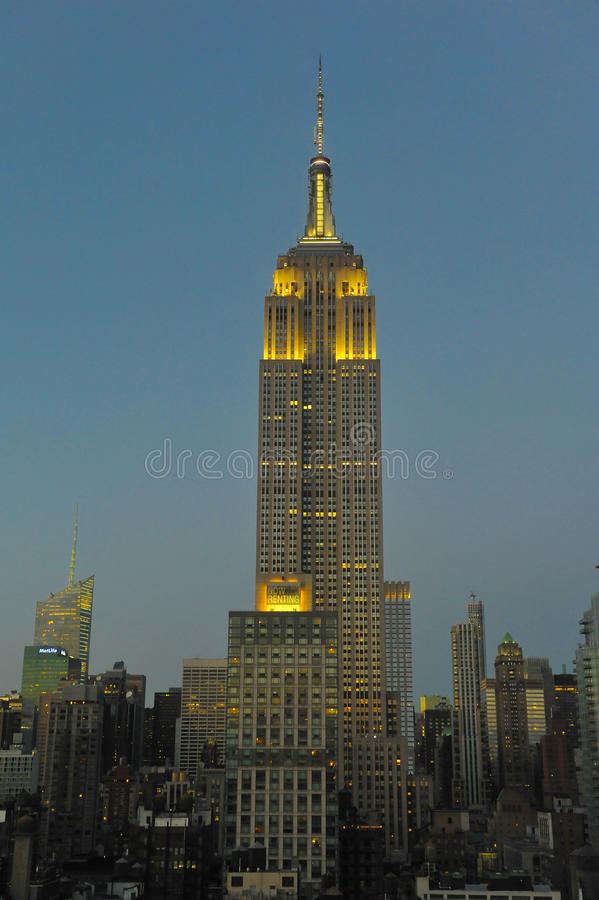 Empire State Building and skyline at dusk with lights on royalty free stock images