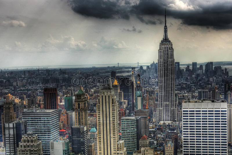 Empire State with dark clouds stock photography