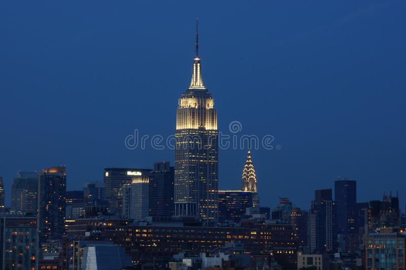 Empire State Towering Over The Chrysler Building royalty free stock photography