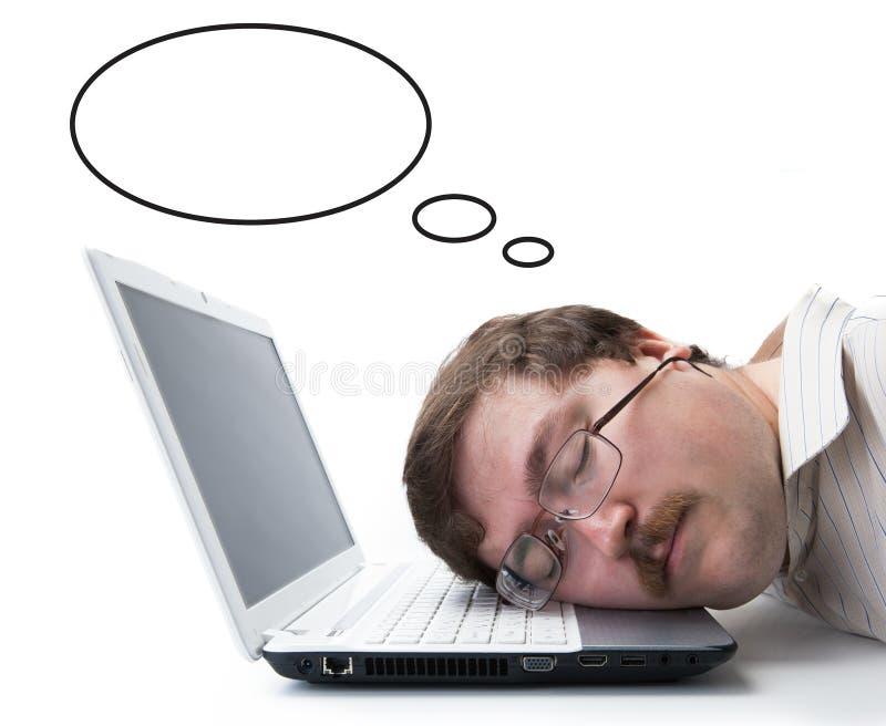 Empleado para los salarios del sueño del ordenador foto de archivo libre de regalías