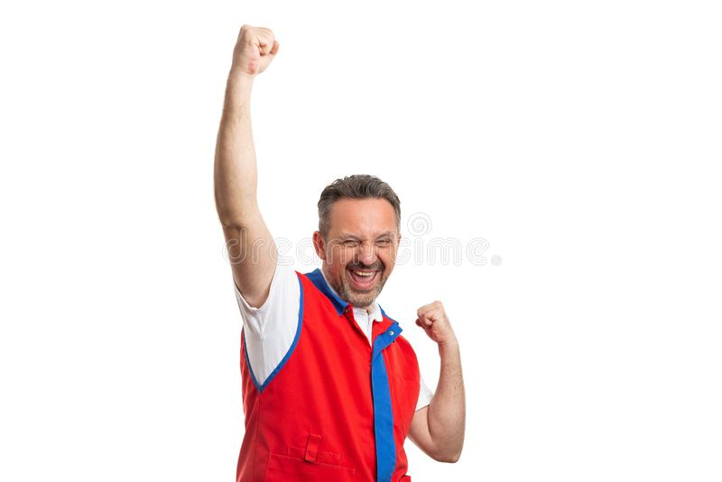 Employé de supermarché avec des bras augmentés en tant que geste enthousiaste image libre de droits