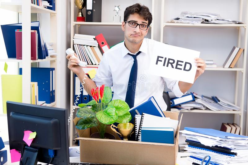 The employee being fired from work made redundant. Employee being fired from work made redundant stock image