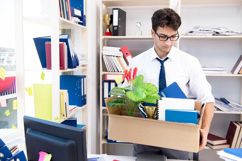The employee being fired from work made redundant. Employee being fired from work made redundant stock photos