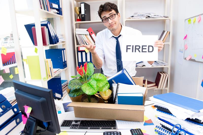 The employee being fired from work made redundant. Employee being fired from work made redundant stock images