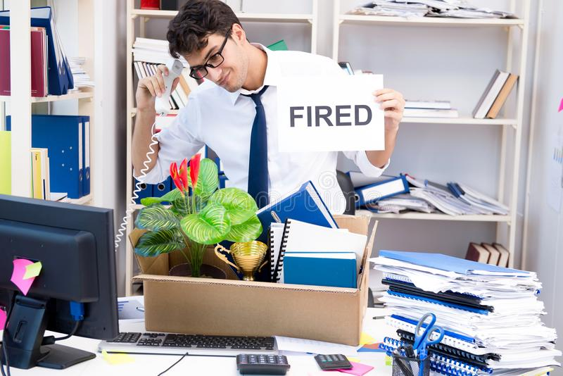 The employee being fired from work made redundant. Employee being fired from work made redundant stock photo