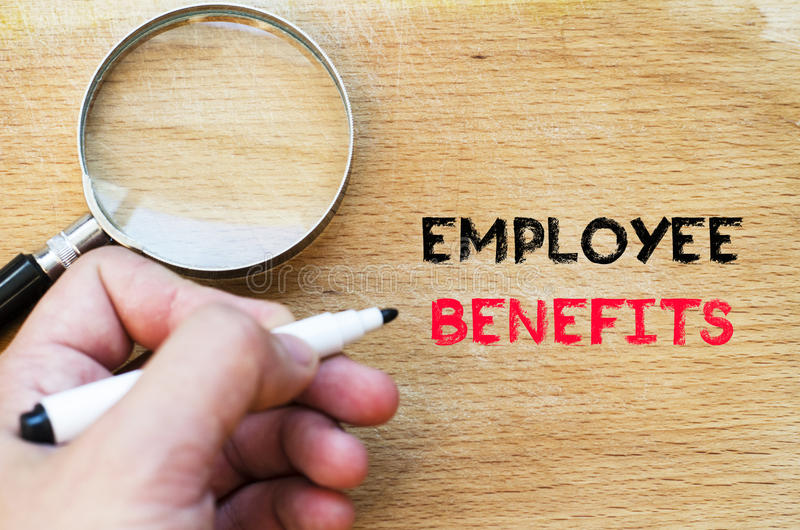 Employee benefits text concept. Human hand over wooden background and employee benefits text concept stock photos