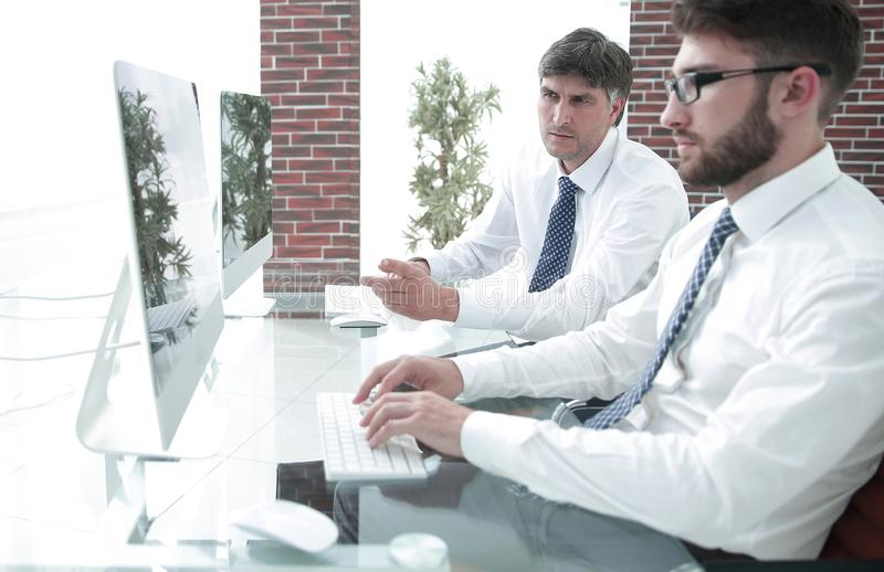 Employee of the company types the text on the PC keyboard royalty free stock photos