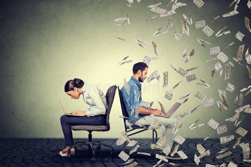 Employee compensation economy concept. Woman working on laptop sitting next to man under money rain. stock photo