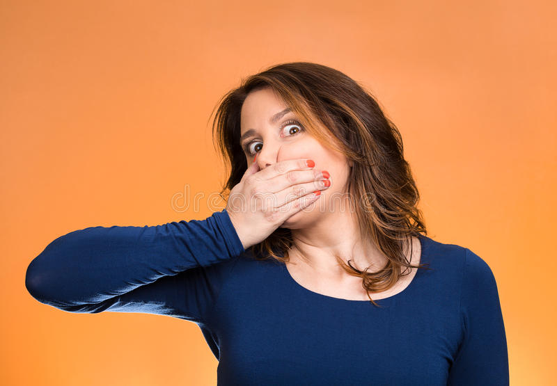 Employee, covering mouth. Speak no evil concept. Closeup portrait middle aged business woman, worker, scared employee, covering mouth. Speak no evil concept royalty free stock photos