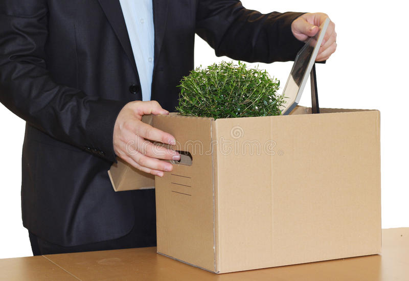 Employee dismissal. Fired employee cardboardbox with personal belongings royalty free stock photos