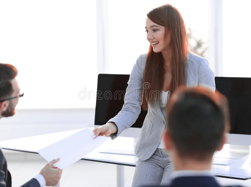 Employee gives the Manager the document. Photo with copy space stock images