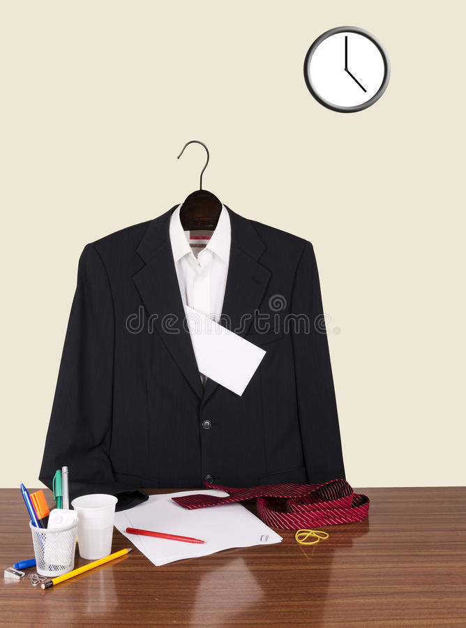 Employee gone home leaving note - suit, letter and clock royalty free stock photos